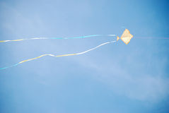 Flying Kite. High Flying Kite in the sky Royalty Free Stock Photo