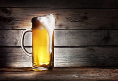 High foamy mug of light beer Royalty Free Stock Image
