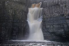 High Force Waterfall on the River Tees and autumn trees royalty free stock photography