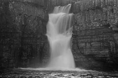 High Force Waterfall on the River Tees and autumn trees stock photo