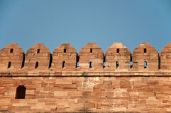 High fort walls against blue sky Stock Image