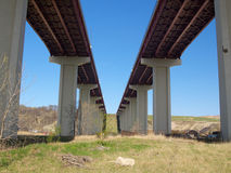 High freeway bridge, underside. Underneath a high bridge across a valley Royalty Free Stock Photography