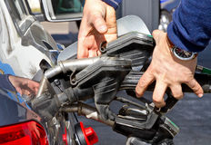 High gas costs. Man with many gas pumps on a filling station Royalty Free Stock Photography