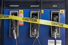 High Gas Prices. Gas station pump wrapped in Caution tape Stock Photos
