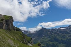 High Gemmipass. Beautiful mountain in summer with snow, green meadow and blue sky in Switzerland. City of Leukerbad, canton Valais, high Gemmipass on 2200 meters stock image