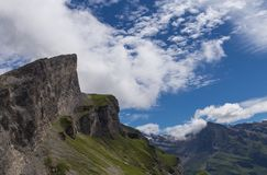 High Gemmipass. Ch. Beautiful mountain in summer with snow, green meadow and blue sky in Switzerland. City of Leukerbad, canton Valais, high Gemmipass on 2200 royalty free stock photo