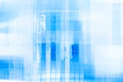 High glass modern building with blue sky and cloud at daylight f. Or abstract background. Soft focus.Facades texture pattern for business background stock photography