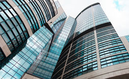 High glass office building with clouds. background Royalty Free Stock Photos