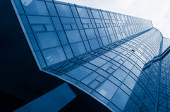 High glass office building with clouds. background Stock Images