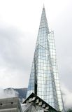 High glass spire building in Andorra. This futuristic high glass spire building is situated in the capital of Andorra, Andorra la Vella, and is housing a Stock Image