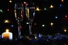 High glasses for champagne. Good New Year spirit. Candles and ch royalty free stock photography