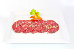 High grade sliced Hida wagyu beef isolated on white background Stock Image