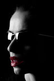 High hand eyewear. Model with bright red lips wearing sunglasses stock image