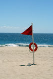 High Hazard Beach Warning Flag. A red high hazard warning flag is an indication of high surf and/or strong currents on this ocean coast Royalty Free Stock Images
