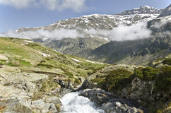 High of Heas valley from Maillet Plateau. The beginning of Heas valley seen from Maillet Plateau of in French Pyrenees in spring, with Maillet watercourse at Stock Photos