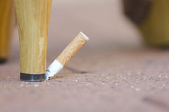High Heel abusing Cigarette Royalty Free Stock Image