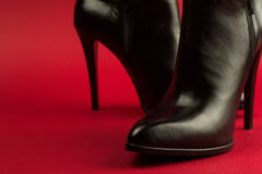 High heel black shoes on red background Royalty Free Stock Photography