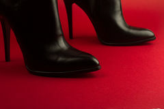 High heel black shoes on red background Stock Image