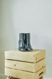 High heel boots on wooden box in walk in closet Royalty Free Stock Photos