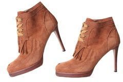 Suede brown high heel pair shoes isolated. Royalty Free Stock Photography