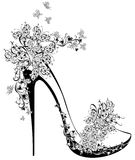 High heel decorated with flowers and butterflies Stock Images
