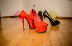 High heel on the floor, black and red Stock Images