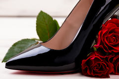 High heel footwear and rose. Stock Photo