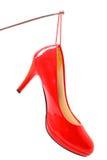 High Heel hung on a nail Stock Photo