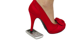 High heel kick through telephone Royalty Free Stock Image