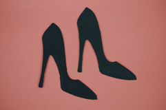 High heel paper cut out with pink background Stock Photos