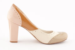 High heel shoe. A high heel shoe on a white background Stock Images