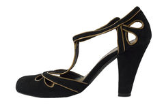 High heel shoe. Black and gold high heel shoe Royalty Free Stock Photo