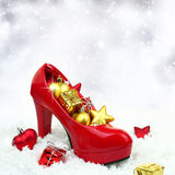 High heel shoe with christmas ornaments Stock Images