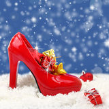 High heel shoe with christmas ornaments Royalty Free Stock Photos