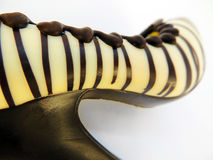 Chocolate shoe. A high heel shoe made of chocolate on a white background Stock Image