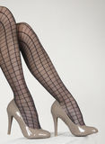 High Heel Shoe and Striped Pantyhose Royalty Free Stock Photos