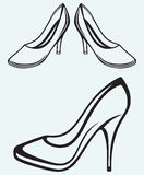 High heel shoes. Isolated on blue background Royalty Free Stock Photos