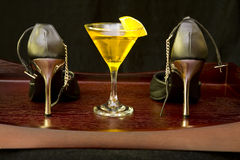 High heel shoes and cocktail on a tray Stock Photo