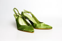 High heel shoes. Green women's vintage shoes isolated on white Stock Image