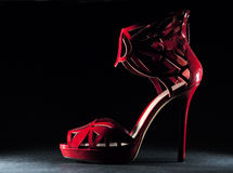 High heel shoes. Image is posed on dark background Stock Image