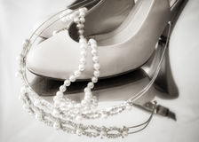 High heel shoes and pearls and tiarra Royalty Free Stock Photos