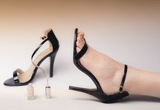 High heel with a silver nail lacquer. High heel and nail lacquer, one women feet with silver nail Royalty Free Stock Photos