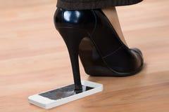 High heel step on broken smartphone Stock Photography