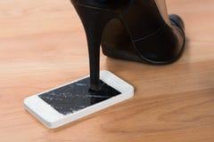 High heel step on broken smartphone Royalty Free Stock Images