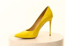 High heel yellow  shoe isolated on white Stock Image