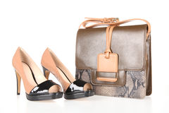 High-heeled boots and leather bag Royalty Free Stock Images
