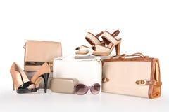 High-heeled boots and leather handbag Stock Image