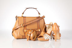 High-heeled boots and leather handbag Stock Image