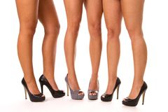 High Heeled Legs. Close up of three women's legs in high heeled shoes Stock Images