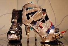 High-heeled shiny shoes. In the shoe store Royalty Free Stock Photos